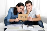 Couple w Help Sign