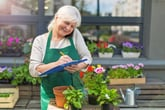 Older woman working at a florist shop