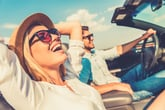 Couple riding in convertible