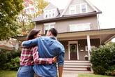 Couple outside a home