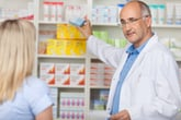 Pharmacist talking to female client
