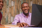 Black man young happy planning computer laptop