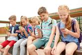 Grade school kids with cellphones