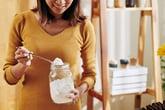 Woman holding a jar of baking soda