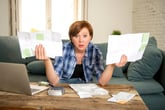 Woman overwhelmed by her expenses