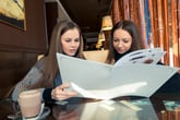 Women reading menu