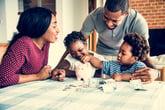Family saving money in a piggy bank