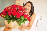 Happy woman getting flowers
