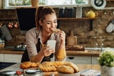 Woman eating bread