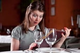 Woman looks at shockingly high wine prices
