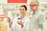 Pharmacist helping a senior with a prescription