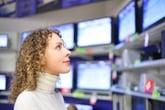 Woman looking at TVs