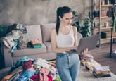 Woman selling old clothes online