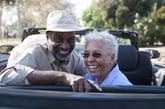 Happy retired couple traveling
