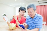 Older couple working on a budget