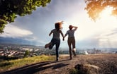 A happy couple runs off to explore the outdoors during the coronavirus crisis