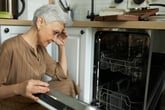 Woman upset by her dishwasher