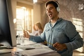 Man listening to music on headphones at work