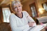 Senior woman sitting at a desk