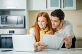Young couple working on improving their finances