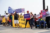 Trump and Biden supporters rally together with signs