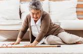 Senior woman falling down