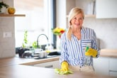 Woman cleaning her kitchen counters
