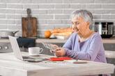 Senior woman counting cash