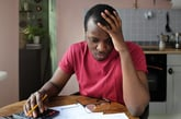 student debt loans man distraught distressed
