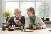 happy senior couple eating breakfast