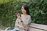 Woman watching her phone