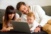Family together around computer