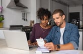 Young couple working on a budget