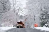 Workers repairing an electrical line during a power outage