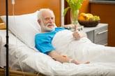 Senior patient in hospital bed.