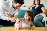 Family saving money with a piggy bank