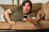 Surprised man watching TV