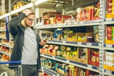 Confused man shopping for groceries