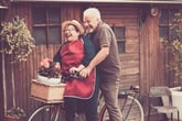 retirees senior couple in front of tiny home