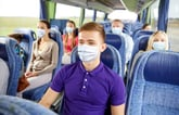 Teen wearing a mask on the bus