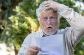 Shocked man reading letter