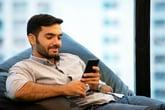 Man checking phone data usage