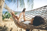 Woman at the beach on vacation with her phone