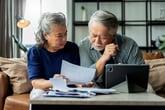 Worried seniors reviewing bills