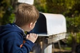 Boy waiting for mail to arrive