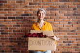 Woman with box of clothing to donate