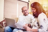 Worried retirees reviewing financial documents