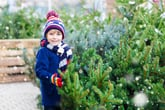 A child with a Christmas tree