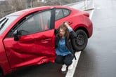 Woman in the rain after a car accident