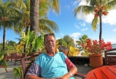 Happy senior retiree living abroad in a tropical area